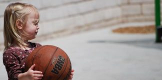 toddler playing with basketball