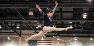 gymnast performing on gymnastics equipment