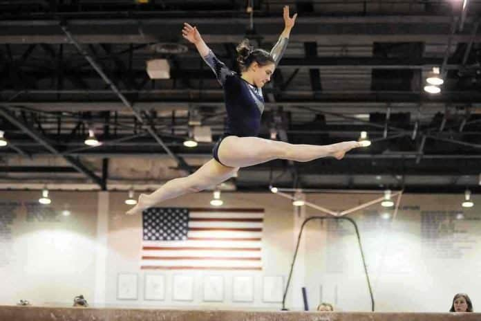 gymnast performing on gymnastics equipment