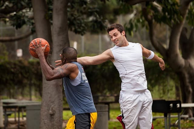 friends playing basketball