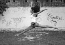 gymnast performing floor routine outdoors