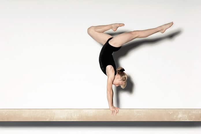 gymnastics praticing on balance beam