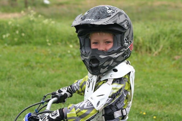 kid riding atv with helmet