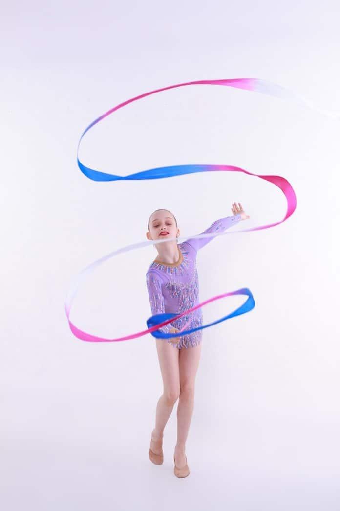 girl wearing gymnastics leotard