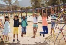 kids swinging on monkey bar
