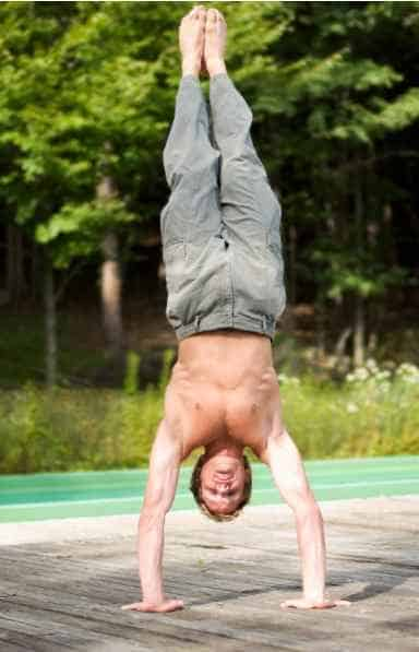 man performing a handstand