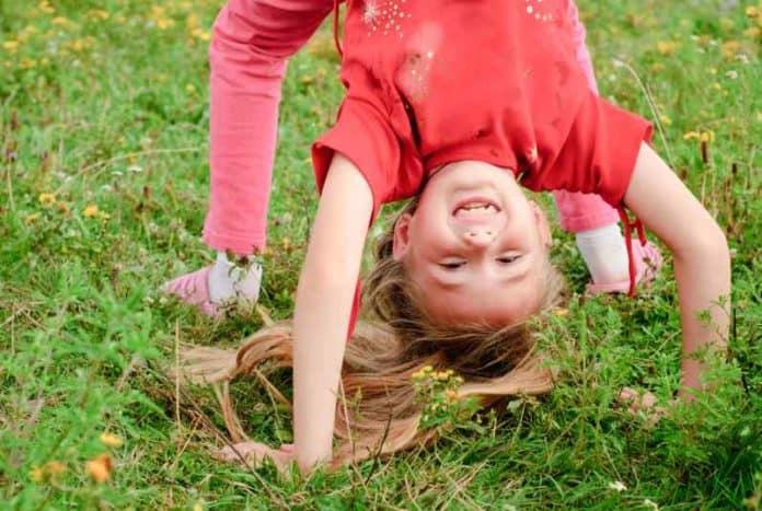 young gymnast having fun before using air barrel