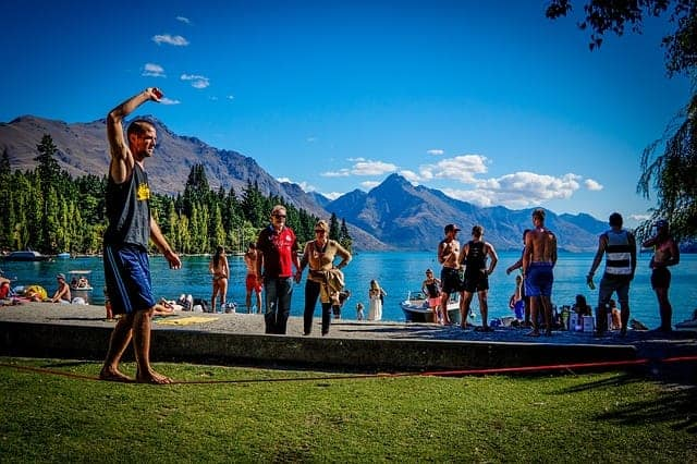 man balancing on slackline course