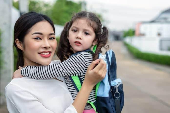 toddler carrying gymnastics bag