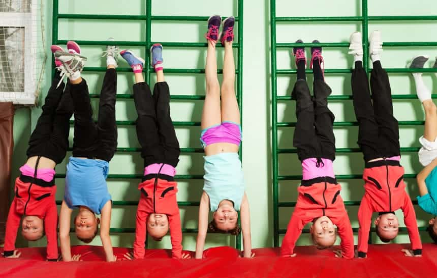 young gymnasts doing a handstand