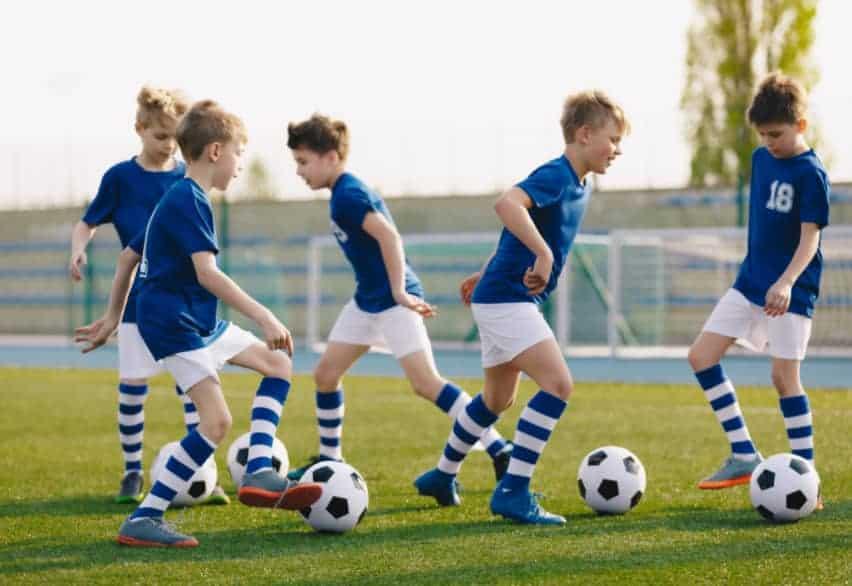 boys practising soccer drills