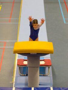 gymnast using springboard to vault
